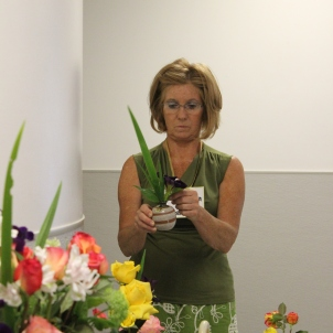 Kathleen Hutton arranging flowers at Rosefest