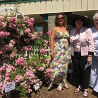 Peggy Martin (Speaker, Teresa Downton and Monica Taylor standing beside the Peggy Martin Rose