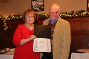John Hefner receiving an award