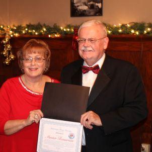 AWARDS BANQUET: Jim Shultz accempting his award.